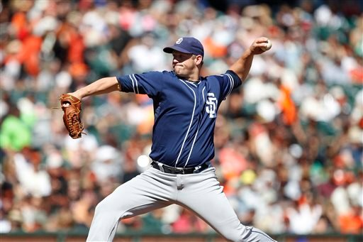 San Diego Padres pitcher Eric Stults (53) throws against the San Francisco Giants during the first inning of a baseball game on Saturday, Sept. 28, 2103, in San Francisco. (AP Photo/Tony Avelar)