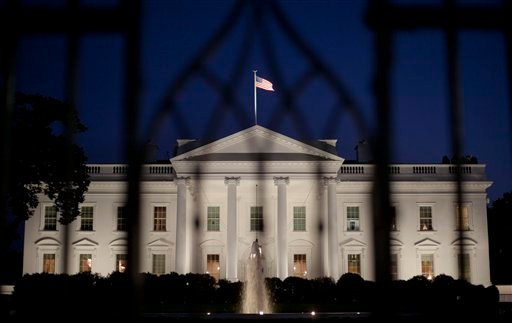 The White House in Washington is seen at night, Monday, Sept. 30, 2013. (AP)