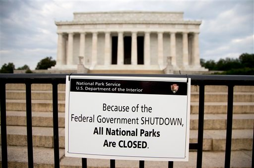 "A sign reading ""Because of the Federal Government SHUTDOWN All National Parks are Closed"" is posted on a barricade in front of the Lincoln Memorial in Washington, Tuesday, Oct. 1, 2013. (AP Photo/Carolyn Kaster)"