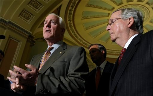 Senate Minority Leader Mitch McConnell of Ky., listens at right as Senate Minority Whip John Cornyn of Texas, left, speaks to reporters on Capitol Hill in Washington, Tuesday, Oct. 1, 2013, following a policy luncheon. (AP)