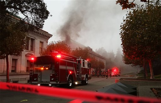 In this image provided by The Daily Californian, fire crews respond to an explosion on the University of California Berkeley campus on Monday, Sept. 30, 2013 in Berkeley, Calif. (AP Photo/The Daily Californian, Kelly Fang)