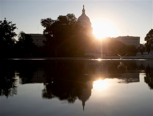 The sun rises behind the Capitol in Washington, Wednesday, Oct. 2, 2013. (AP)