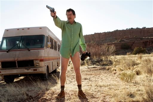 "This image released by AMC shows Walter White, played by Bryan Cranston, next to the Winnebago he uses as a mobile meth lab in the pilot episode of ""Breaking Bad."" The series finale of the popular drama series aired Sept. 29. (AP Photo/AMC, Doug Hyun)"