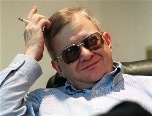 In this Feb. 4, 1998 file photo, writer Tom Clancy appears at his home in Calvert County, Md. Clancy, the bestselling author of more than 25 fiction and nonfiction books for the Penguin Group, died on Oct. 1, 2013 in Baltimore, Md.  (AP Photo/Vince Lupo)