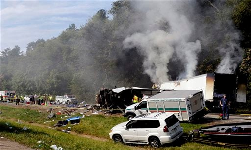 Emergency personnel search the scene near a collision involving a bus on I-40, in Dandridge, Tenn, on Wednesday, Oct. 2, 2013.  (AP)