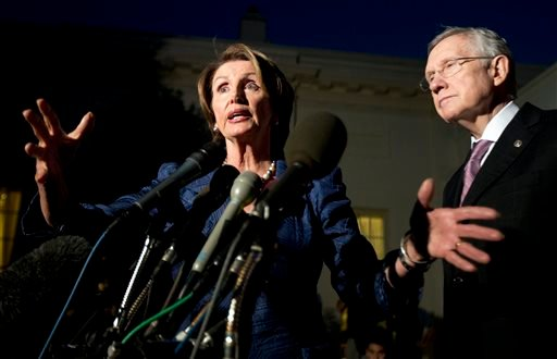 House Minority Leader Rep. Nancy Pelosi, D-Calif., left, with Senate Majority Leader Sen. Harry Reid, D-Nev., speaks to reporters following a meeting with President Obama at the White House Oct. 2, 2013. (AP Photo/Manuel Balce Ceneta)
