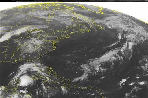 This NOAA satellite image taken Thursday, Oct. 3, 2013 at 1:45 a.m. EDT shows a low pressure system tracking across the Northern Plains with showers and thunderstorms. (AP PHOTO/WEATHER UNDERGROUND)