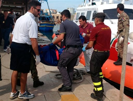 Firefighters unload the body of a drowned migrant from a Coast Guard boat in the port of Lampedusa, Sicily, Thursday, Oct. 3, 2013.(AP Photo/Nino Randazzo, Health Care Service, HO)
