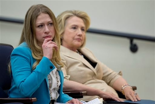 This Sept. 9, 2013 photo, former Secretary of State Hillary Rodham Clinton sits with her daughter Chelsea Clinton before she speaks about Syria in the South Court Auditorium.(AP Photo/Carolyn Kaster)