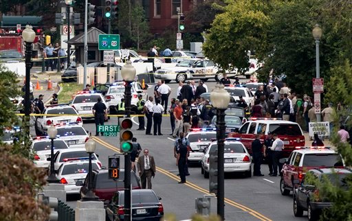 View from Russell Senate Office Building: Police converging on the scene of a shooting on Constitution Ave on Capitol Hill near Supreme Court in Washington Oct. 3, 2013. (AP Photo/J. Scott Applewhite)