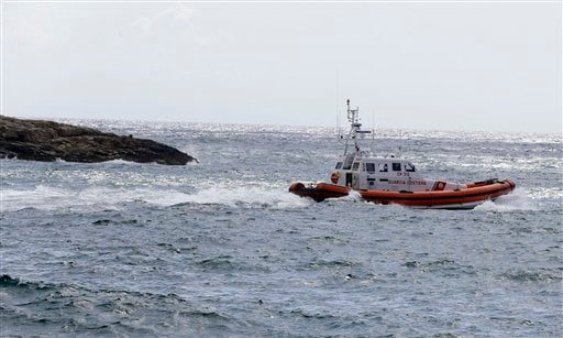 A Coast Guard boat leaves the harbor of the island of Lampedusa, southern Italy, Friday, Oct. 4, 2013.