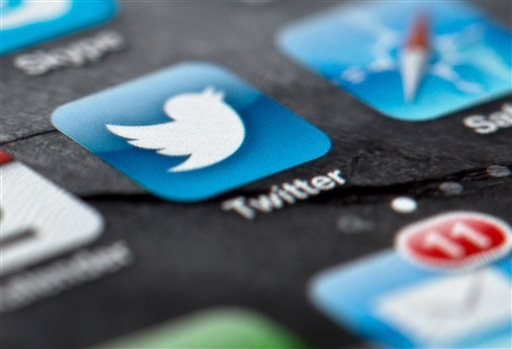In this Feb. 2, 2013, file photo, a smartphone display shows the Twitter logo in Berlin, Germany, Twitter unsealed the documents Thursday, Oct. 3, 2013, for its planned initial public offering of stock and says it hopes to raise up to $1 billion.