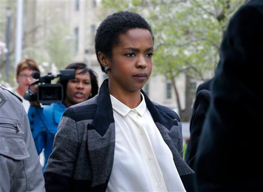 FILE - An April 22, 2013, file photo shows singer Lauryn Hill walking from federal court in Newark, N.J. (AP)
