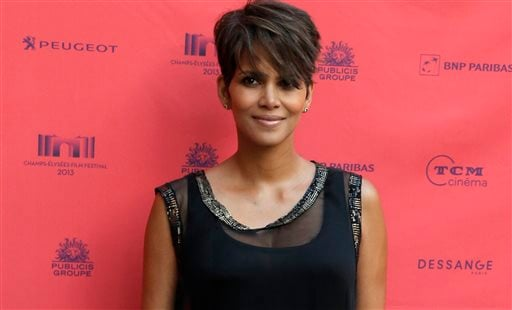 "In this June 13, 2013 file photo, actress Halle Berry arrives at the screening of the film ""Things we Lost in the Fire"" with the french title ""Nos Souvenirs Brules"" during the Champs-Elysees Film Festival, at the ""Publicis Cinema"" in Paris."