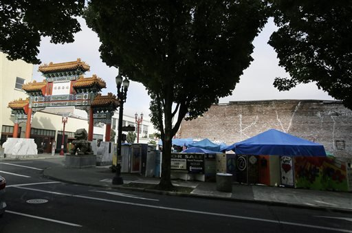 This Oct. 4, 2013, photo, shows the Right 2 Dream Too homeless camp next to the Chinatown gate in Portland, Ore.