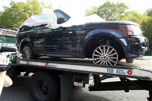 The Range Rover involved in the bikers attack is being moved from the police precinct for further police investigation Saturday, Oct. 5, 2013 in New York.
