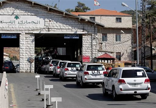 A convoy of inspectors from the Organization for the Prohibition of Chemical Weapons prepares cross into Syria at the Lebanese border crossing point of Masnaa, eastern Bekaa Valley, Lebanon, Tuesday, Oct. 1, 2013.
