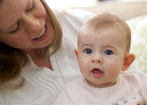 In this photo taken Sept. 24, 2013, Holly Sloan interacts with her baby Amelia at their home in Warrenton, Va.