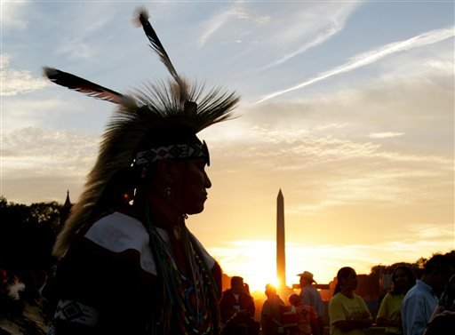 In this Tuesday, Sept. 21, 2004 photo, a member of the Northern Arapaho Tribe who lives on the Wind River Indian Reservation in Wyoming, attends the festivities on the National Mall for the opening of the National Museum of the American Indian.