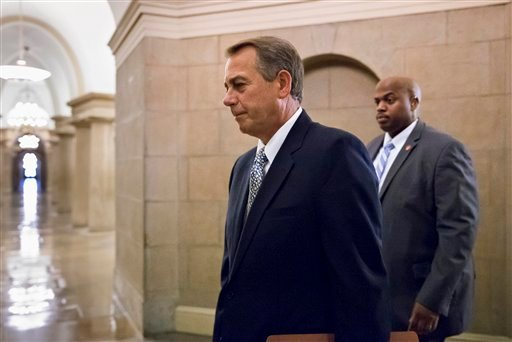 House Speaker John Boehner of Ohio arrives on Capitol Hill in Washington, Monday, Oct. 7, 2013.