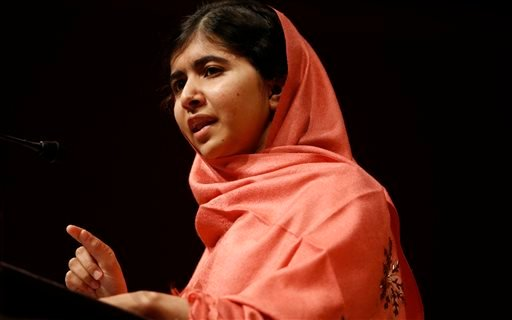 In this Friday, Sept. 27, 2013 file photo, Malala Yousafzai addresses students and faculty after receiving the 2013 Peter J. Gomes Humanitarian Award at Harvard University, on the school's campus in Cambridge, Mass.