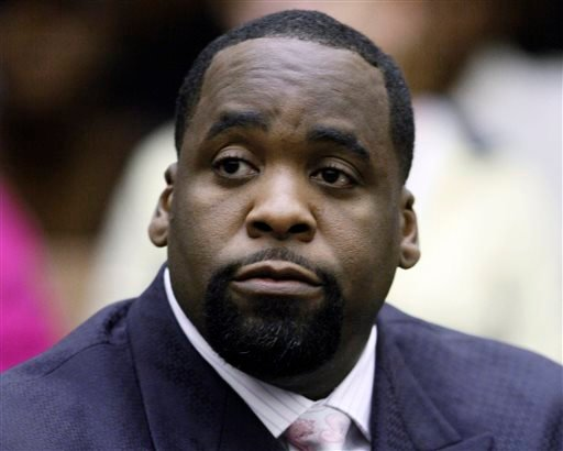 In this May 25, 2010 file photo, former Detroit Mayor Kwame Kilpatrick sits at his sentencing in Wayne County Circuit Court on an obstruction-of-justice conviction. (AP Photo/Paul Sancya, File)