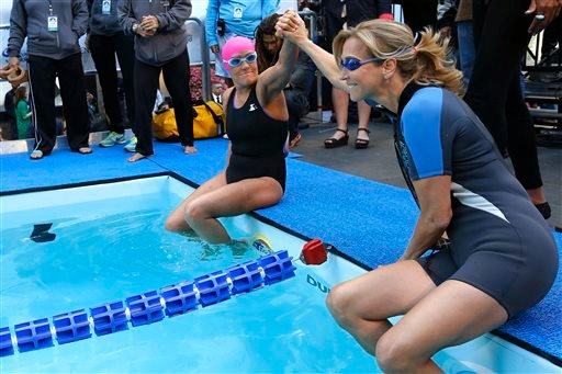 "Long-distance swimmer Diana Nyad, left, who recently completed a record-breaking swim from Cuba to Florida, is joined by ""Good Morning America"" anchor Lara Spencer. (AP Photo/Jason DeCrow)"
