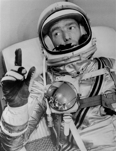 FILE - In this May 24, 1962 file photo provided by NASA, astronaut Scott Carpenter gestures with one hand after donning his space suit in Hangar S prior to being shot into orbit at Cape Canaveral, Fla. (AP)
