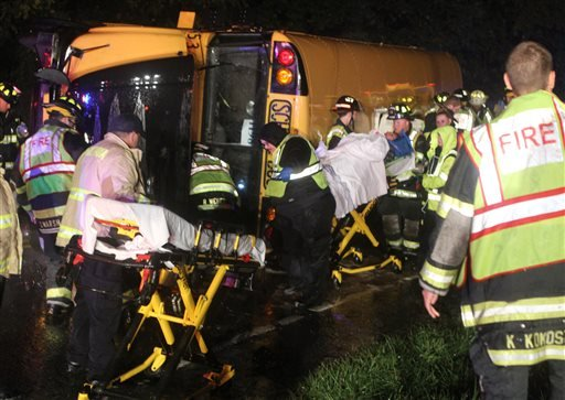 A victim is wheeled to an ambulance after a bus overturned on Howell School Road at the intersection with Summit Bridge Road after colliding with a carcarrier truck, reported about 10:00 p.m. Thursday evening, Oct. 10, 2013.