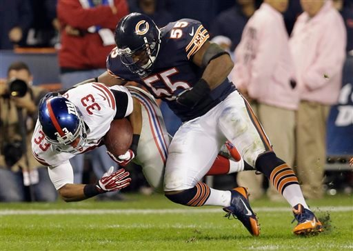 Chicago Bears linebacker Lance Briggs (55) tackles New York Giants running back Da'Rel Scott (33) in the second half of an NFL football game, Thursday, Oct. 10, 2013, in Chicago. (AP Photo/Nam Y. Huh)