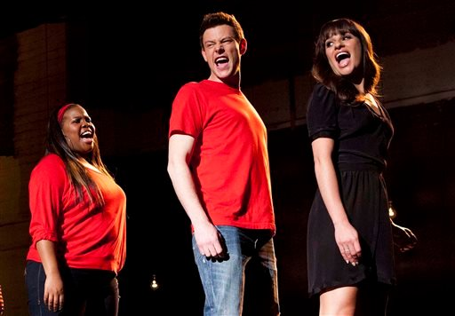"""In this undated image released by Fox, cast members, from left, Amber Riley, Cory Monteith and Lea Michele perform during a scene from """"Glee."""""""