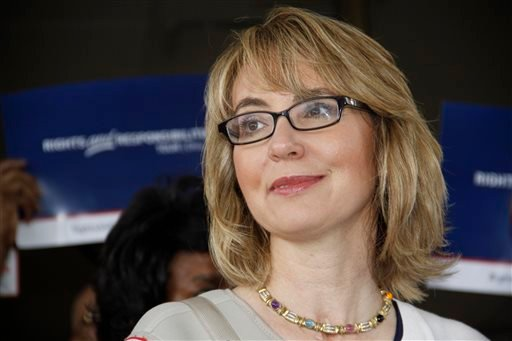 Former U.S. Rep. Gabrielle Giffords talks to supporters before she and husband, former astronaut Mark Kelly, take part in a parade in Northside, a suburb of Cincinnati, in this July 4, 2013 file photo.
