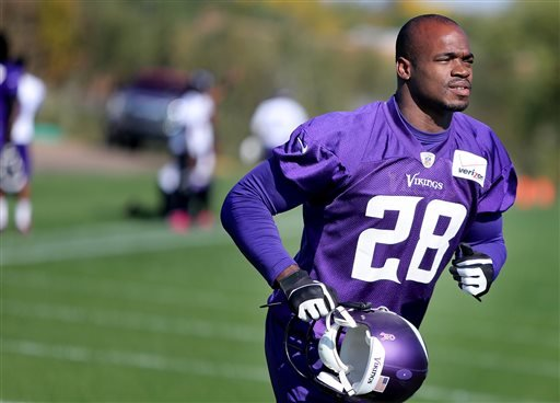 Minnesota Vikings' Adrian Peterson makes his way off an NFL football practice field at Winter Park in Eden Prairie, Minn., Friday, Oct. 11, 2013.