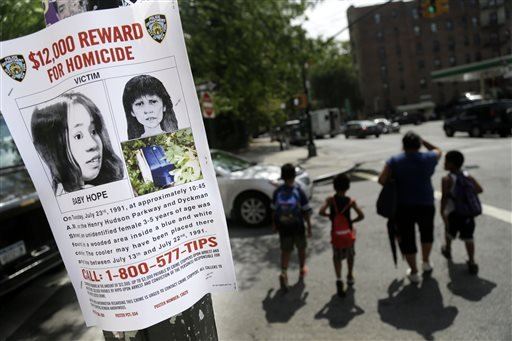 In this July 23, 2013, file photo shows a poster soliciting information regarding an unidentified body near the site where the body was found in New York.