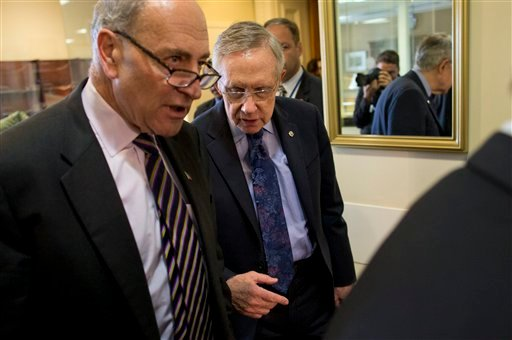 Sen. Chuck Schumer, D-N.Y., left, and Senate Majority Leader Sen. Harry Reid, D-Nev., arrive for a news conference on Capitol Hill on Saturday, Oct. 12, 2013 in Washington.