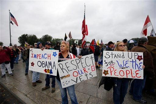 People rally at the World War II Memorial in Washington Sunday, Oct. 13, 2013.