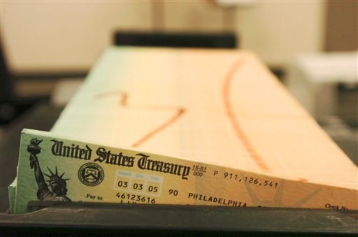 In this Feb. 11, 2005 file photo, trays of printed social security checks wait to be mailed from the U.S. Treasury's Financial Management services facility in Philadelphia.