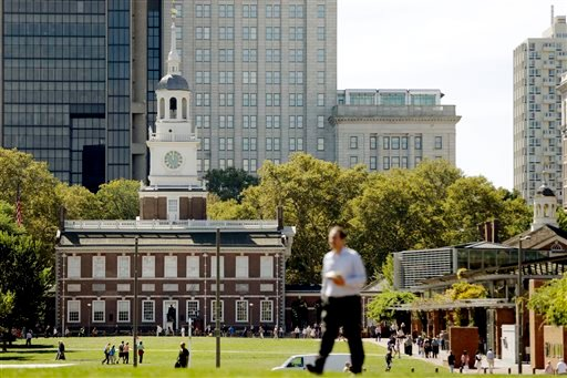 A man walks past Independence Hall at Independence National Historical Park in Philadelphia, Monday, Sept. 30, 2013 as the government teeters on the brink of a partial shutdown at midnight unless Congress can reach an agreement on funding.