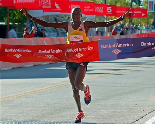 Dennis Kimetto of Kenya crosses the finish line to win the Chicago Marathon on Sunday, Oct. 13, 2013, in Chicago. (AP Photo/Andrew A. Nelles)