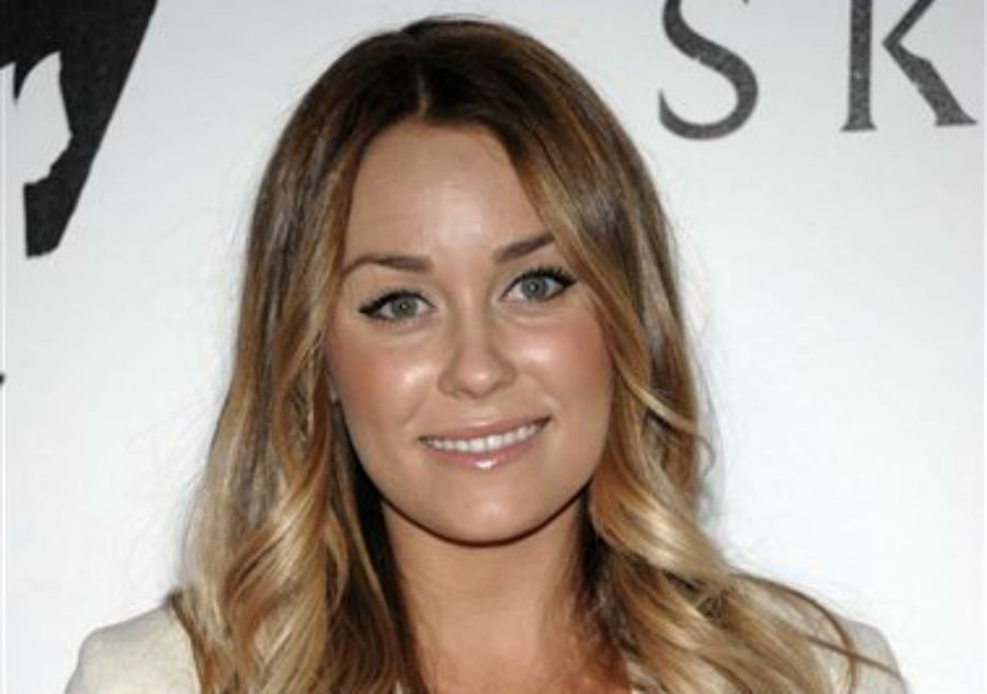 "In this Nov. 8, 2011 file photo, Lauren Conrad arrives at the launch party for the video game ""The Elder Srolls V: Skyrim"" in Los Angeles. Conrad announced Sunday, Oct. 13, 2013, that she is engaged to musician William Tell."