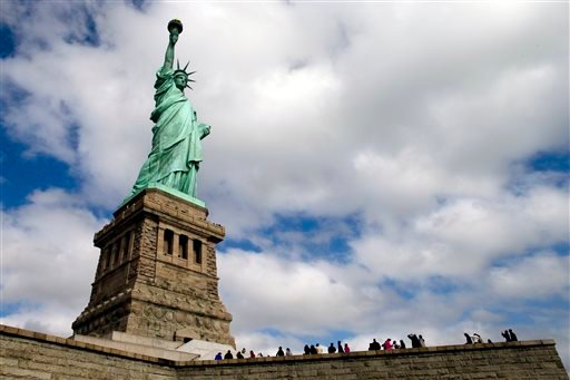 Tourists visit the Statue of Liberty in New York Harbor, Sunday, Oct. 13, 2013, in New York.