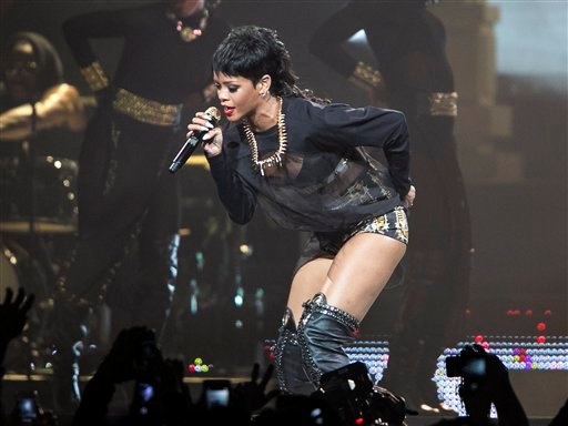 In this Sept. 24, 2013 file photo, Rihanna performs in Perth, Australia during the first concert of the Australian leg of her Diamonds World Tour.