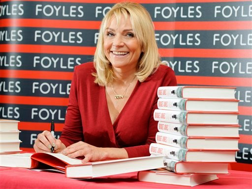 """In this photo taken Thursday, Oct. 10, 2013, British author Helen Fielding attends a photocall ahead of a signing session for her new book """"Bridget Jones: Mad About The Boy,"""" at a bookshop in central London."""