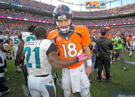 Denver Broncos quarterback Peyton Manning (18) greets Jacksonville Jaguars running back Justin Forsett (21) after the Broncos beat the Jaguars 35-19in an NFL football game, Sunday, Oct. 13, 2013, in Denver. (AP Photo/Jack Dempsey)
