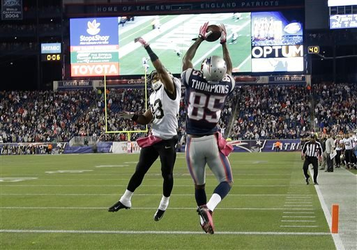 New England Patriots wide receiver Kenbrell Thompkins (85) catches the winning touchdown pass against New Orleans Saints cornerback Jabari Greer (33) in the fourth quarter of an NFL football game Sunday, Oct.13, 2013, in Foxborough, Mass. (AP)
