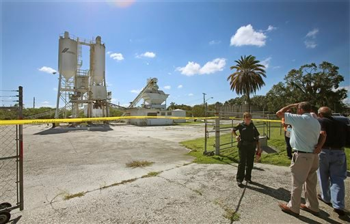 In this Sept. 10, 2013 file photo, Polk County Sheriff personnel investigate the death of 12-year-old girl, Rebecca Ann Sedwick, at an old cement plant in Lakeland, Fla.