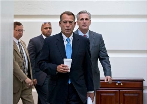 Speaker of the House John Boehner, R-Ohio, with House Majority Whip Kevin McCarthy, R-Calif., right, walks to a meeting of House Republicans at the Capitol in Washington, Tuesday, Oct. 15, 2013, as a partial government shutdown enters its third week.