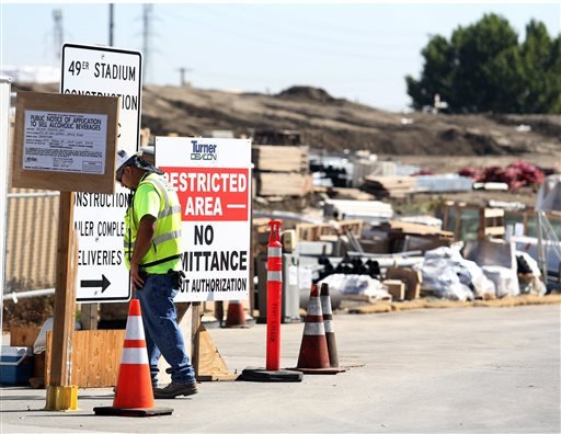 A security guard walks by a construction entrance at the Forty-Niners' new stadium Monday, Oct. 14, 2013, in Santa Clara, Calif., where a second worker has been killed in an accident in less than four months.