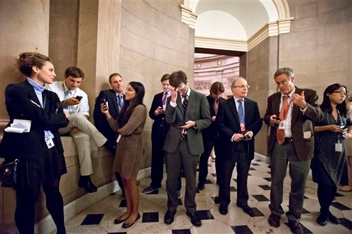 Reporters wait outside the office of Speaker of the House John Boehner, R-Ohio, as a planned vote in the House of Representatives collapsed, Tuesday night, Oct. 15, 2013, at the Capitol. (AP Photo/J. Scott Applewhite)