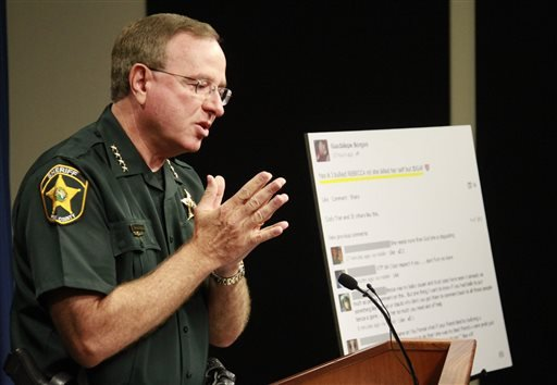 Polk County Sheriff Grady Judd talks about the events leading up to the arrest over the weekend of two juvenile girls in a Florida bullying case at a press conference in Winter Haven Oct. 15, 2013. (AP Photo/The Ledger, Calvin Knight)